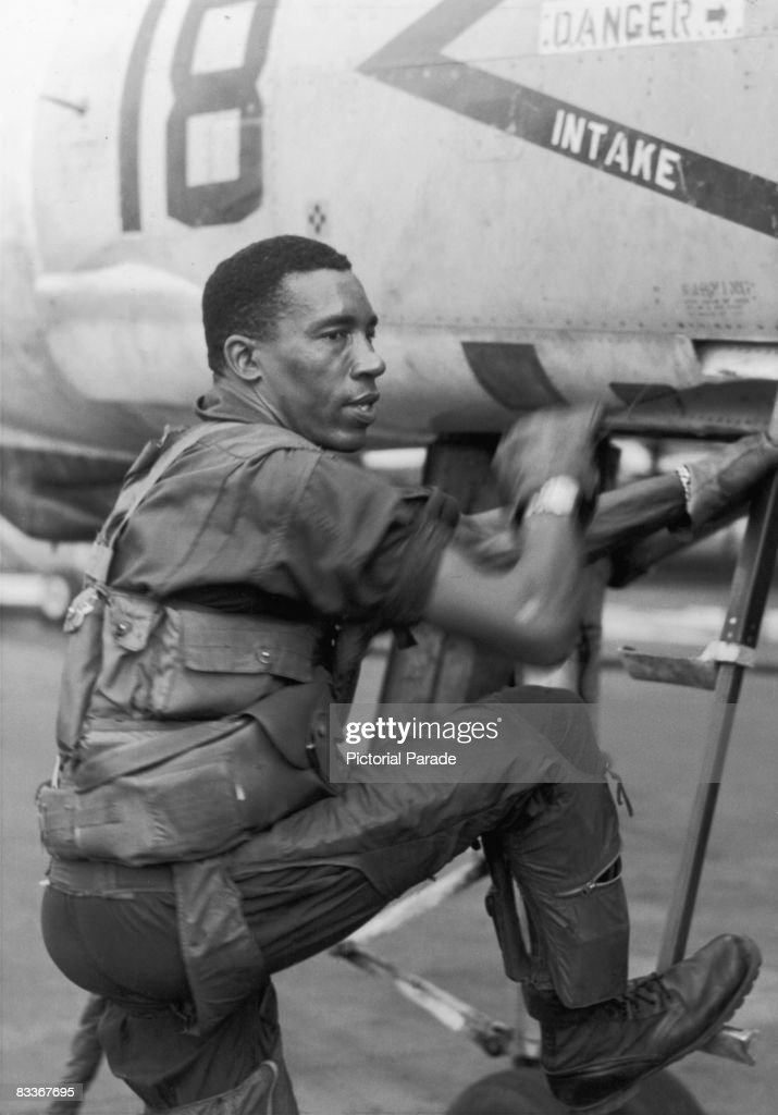Frank E. Petersen of the United States Marine Corps boards a McDonnell Douglas F-4 Phantom II, circa 1968. In 1979 he became the first African-American Marine Corps general.