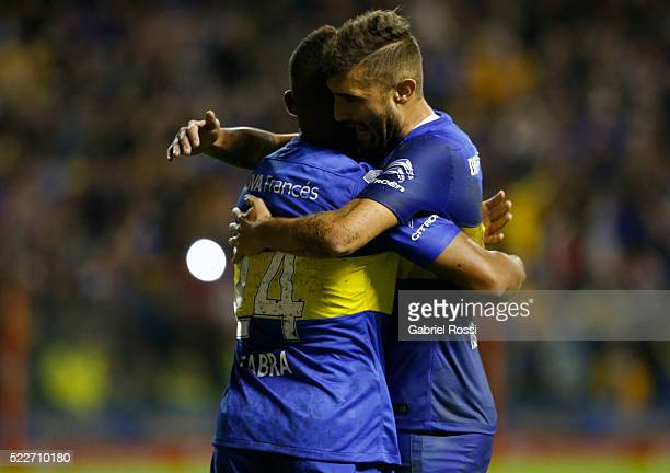 Frank Fabra of Boca Juniors celebrates with Gino Peruzzi after scoring the first goal of his team during a match between Boca Juniors and Deportivo...