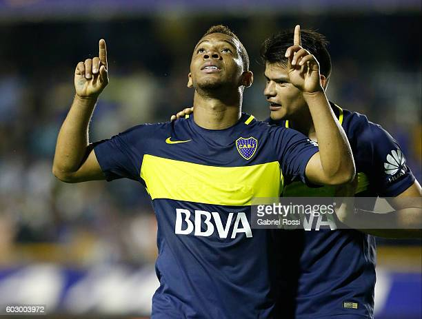 Frank Fabra of Boca Juniors celebrates with teammate Walter Bou after scoring the third goal of his team during a match between Boca Juniors and...