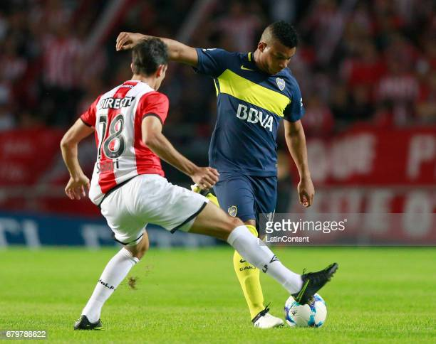 Frank Fabra of Boca Juniors fights for the ball with Augusto Solari of Estudiantes de La Plata during a match between Estudiantes and Boca Juniors as...