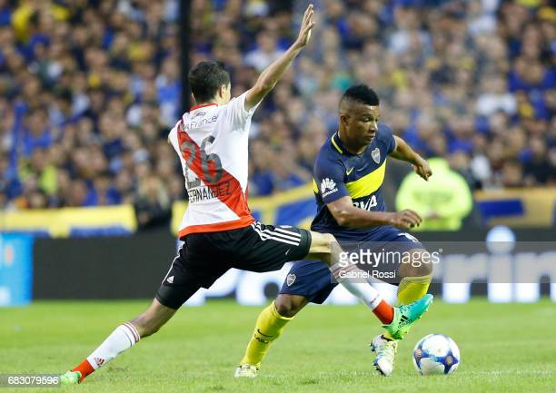 Frank Fabra of Boca Juniors fights for the ball with Ignacio Fernandez of River Plate during a match between Boca Juniors and River Plate as part of...