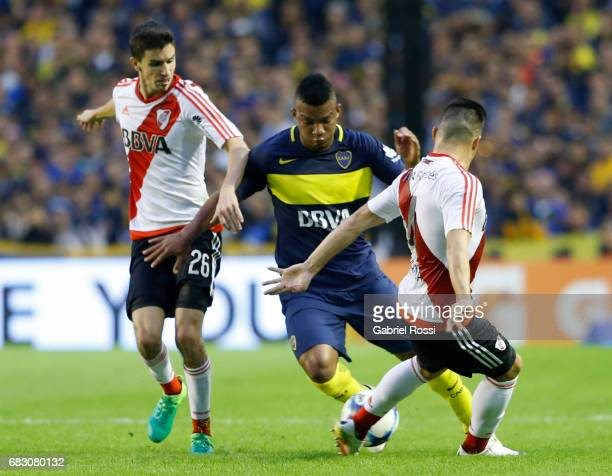 Frank Fabra of Boca Juniors fights for the ball with Jorge Luis Moreira of River Plate during a match between Boca Juniors and River Plate as part of...