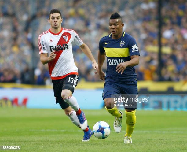 Frank Fabra of Boca Juniors fights for the ball with Lucas Alario of River Plate during a match between Boca Juniors and River Plate as part of...