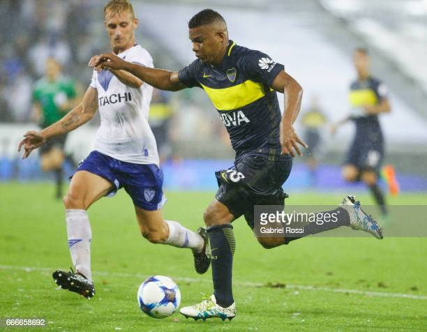 Frank Fabra of Boca Juniors fights for the ball with Maximiliano Caire of Velez Sarsfield during a match between Velez Sarsfield and Boca Juniors as...
