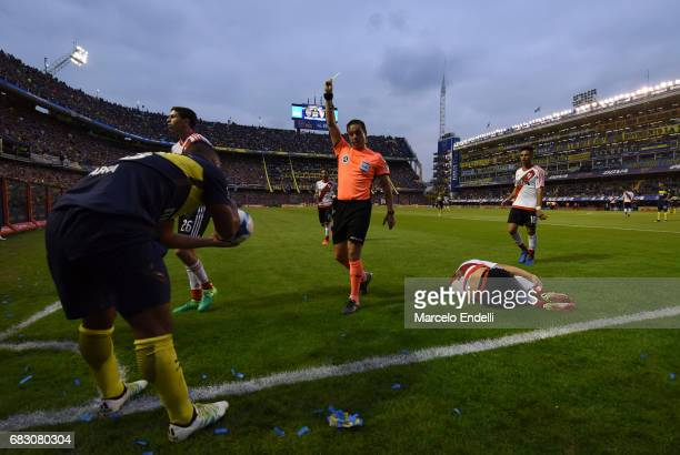 Frank Fabra of Boca Juniors recieves a yellow card during a match between Boca Juniors and River Plate as part of Torneo Primera Division 2016/17 at...
