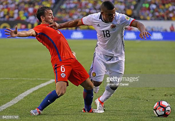 Frank Fabra of Colombia holds off Jose Pedro Fuenzalida of Chile during a semifinal match in the 2016 Copa America Centernario at Soldier Field on...