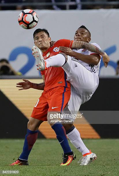 Frank Fabra of Colombia kicks the ball away from Charles Aranguiz of Chile during a semifinal match in the 2016 Copa America Centernario at Soldier...