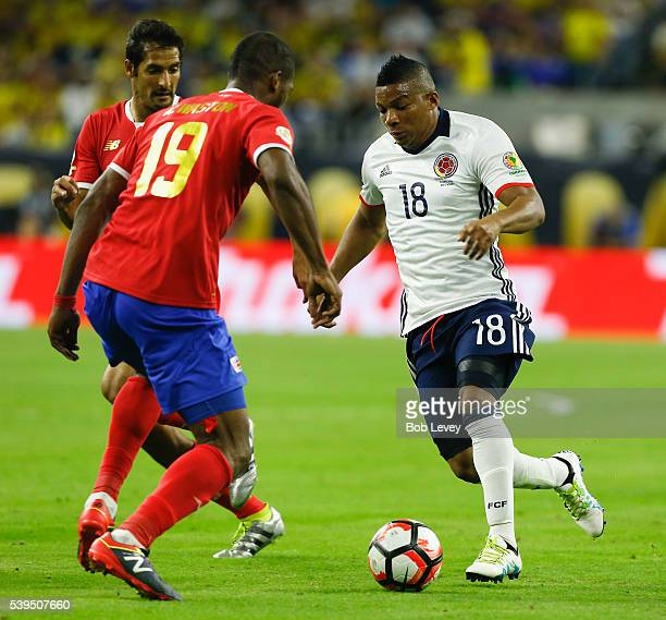 Frank Fabra of Colombia looks to advance the ball on Kendall Watson of Costa Rica in thye second half at NRG Stadium on June 11 2016 in Houston Texas