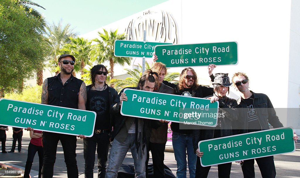 [L-R] Frank Ferrer, Richard Fortus, Ron 'Bumblefoot' Thal, Chris Pittman, Dizzy Reed, Dj Ashba and Tommy Stinson of the band of Guns N' Roses join Clark County Commissioner Mary Beth Scow,Hard Rock Hotel COO Jody Lake and Director of Entertainent Paul Davis to rename Paradise Road as 'Paradise City Road' in honour of Guns N' Roses residency at Hard Rock Hotel and Casino on October 29, 2012 in Las Vegas, Nevada.