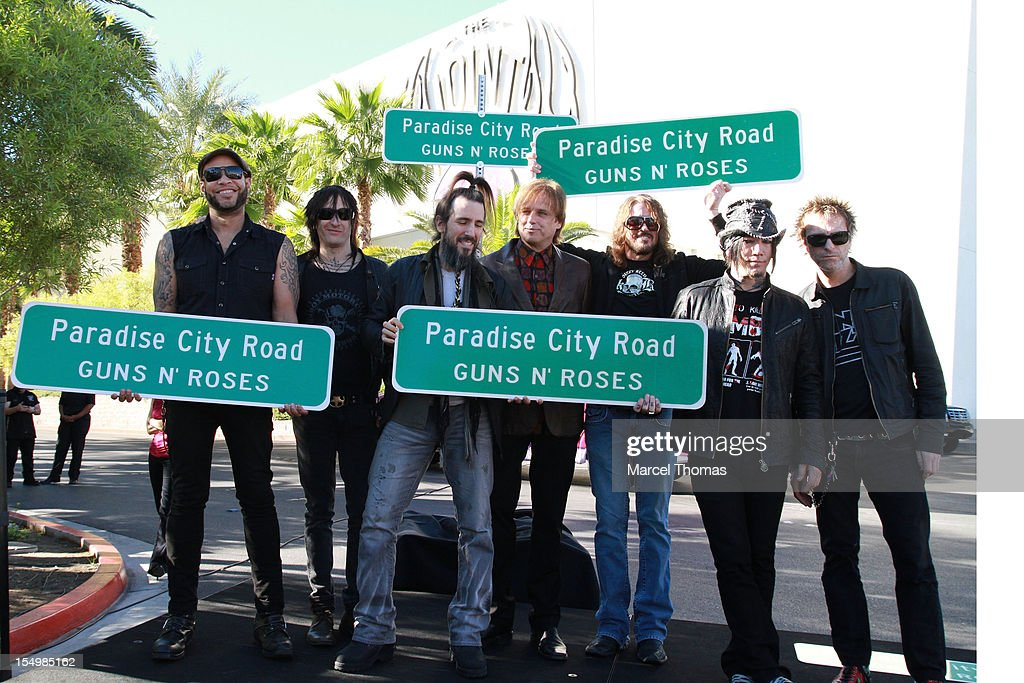 [L-R] Frank Ferrer, Richard Fortus, Ron 'Bumblefoot' Thal, Chris Pittman, Dizzy Reed, Dj Ashba and <a gi-track='captionPersonalityLinkClicked' href=/galleries/search?phrase=Tommy+Stinson&family=editorial&specificpeople=4341822 ng-click='$event.stopPropagation()'>Tommy Stinson</a> of the band of Guns N' Roses join Clark County Commissioner Mary Beth Scow,Hard Rock Hotel COO Jody Lake and Director of Entertainent Paul Davis to rename Paradise Road as 'Paradise City Road' in honour of Guns N' Roses residency at Hard Rock Hotel and Casino on October 29, 2012 in Las Vegas, Nevada.
