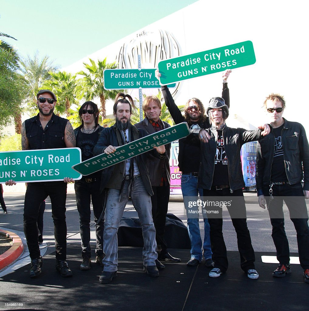 [L-R] Frank Ferrer, Richard Fortus, Ron 'Bumblefoot' Thal, Chris Pittman, Dizzy Reed, Dj Ashba and <a gi-track='captionPersonalityLinkClicked' href=/galleries/search?phrase=Tommy+Stinson&family=editorial&specificpeople=4341822 ng-click='$event.stopPropagation()'>Tommy Stinson</a> of the band Guns N' Roses join Clark County Commissioner Mary Beth Scow,Hard Rock Hotel COO Jody Lake and Director of Entertainent Paul Davis to rename Paradise Road as 'Paradise City Road' in honour of Guns N' Roses residency at Hard Rock Hotel and Casino on October 29, 2012 in Las Vegas, Nevada.