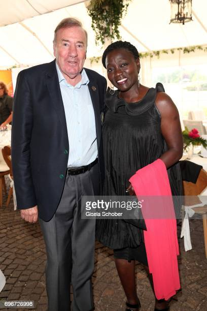 Frank Fleschenberg and Dr Auma Obama sister of Barack Obama during the 2nd I'm Living Charity Golf Cup at Golfclub Beuerberg on June 16 2017 in...