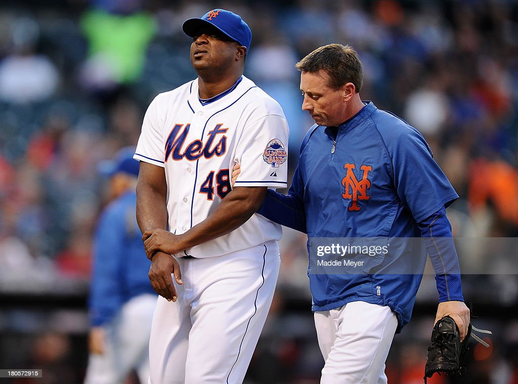 Frank Francisco #48 of the New York Mets is escorted off of the field after being hit by a batted ball during the eighth inning of the game against the Miami Marlins at Citi Field on September 14, 2013 in the Flushing neighborhood of the Queens borough of New York City.