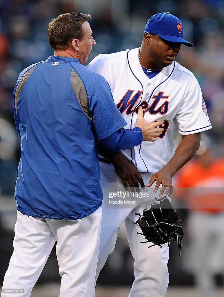 <a gi-track='captionPersonalityLinkClicked' href=/galleries/search?phrase=Frank+Francisco&family=editorial&specificpeople=798081 ng-click='$event.stopPropagation()'>Frank Francisco</a> #48 of the New York Mets is escorted off of the field after being hit by a batted ball during the eighth inning of the game against the Miami Marlins at Citi Field on September 14, 2013 in the Flushing neighborhood of the Queens borough of New York City.