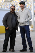 Frank Fritz and Mike Wolfe hosts of the hit television series American Pickers look on in the garage during testing at Daytona International Speedway...