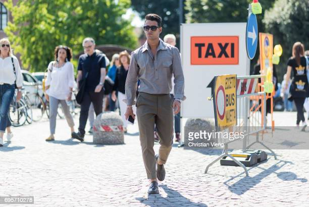 Frank Gallucci wearing a grey button shirt olive pants is seen during Pitti Immagine Uomo 92 at Fortezza Da Basso on June 13 2017 in Florence Italy