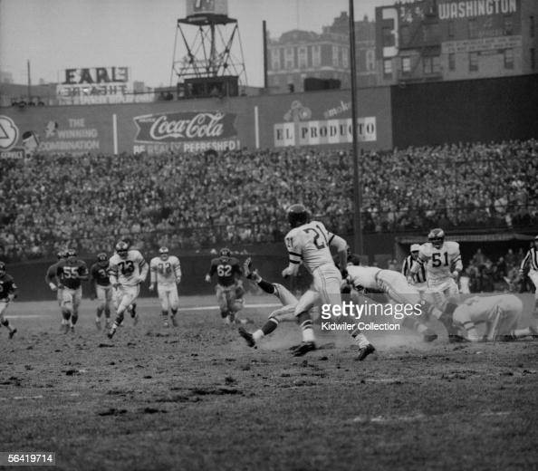 Frank Gifford of the New York Giants is sacked from behind by Chuck Bednarik of the Philadelphia Eagles to stop the last chance the Giants had of...