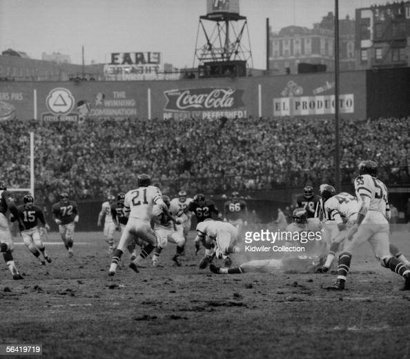 Frank Gifford of the New York Giants lays hurt on the field after being hit by Chuck Bednarik of the Philadelphia Eagles to stop the last chance the...