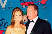 Frank Gifford with his wife Kathie Lee Gifford in front of a cartoon backdrop circa 1990 New York