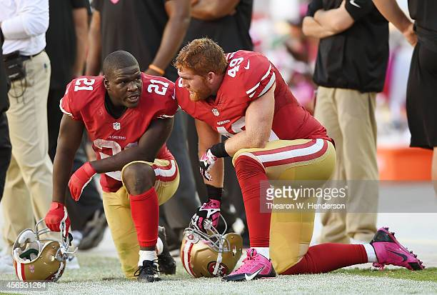 Frank Gore and Bruce Miller of the San Francisco 49ers talking with each other on the sidelines against the Kansas City Chiefs during the fourth...