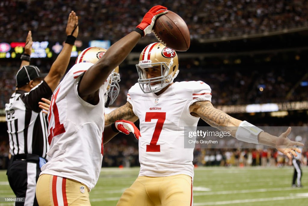 Frank Gore #21 and Colin Kaepernick #7 of the San Francisco 49ers celebrate after scoring a touchdown against the New Orleans Saints at The Mercedes-Benz Superdome on November 25, 2012 in New Orleans, Louisiana.