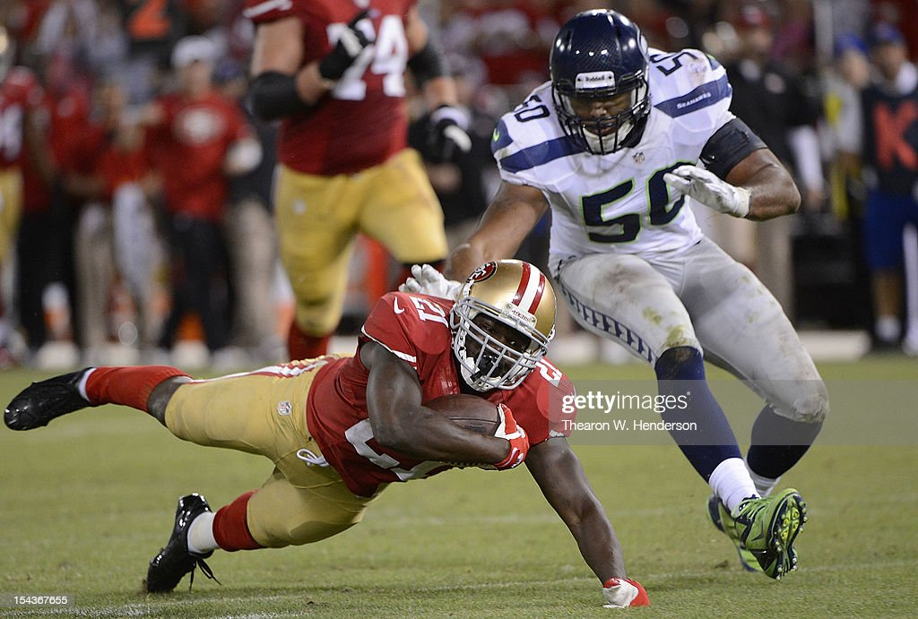 <a gi-track='captionPersonalityLinkClicked' href=/galleries/search?phrase=Frank+Gore&family=editorial&specificpeople=233698 ng-click='$event.stopPropagation()'>Frank Gore</a> #21 of the San Francisco 49ers after a thirty seven yard gain stumbles and is touched to the ground by K.J. Wright #50 of the Seattle Seahawks during the fourth quarter of an NFL football game at Candlestick Park on October 18, 2012 in San Francisco, California. The 49ers won the game 13-6.