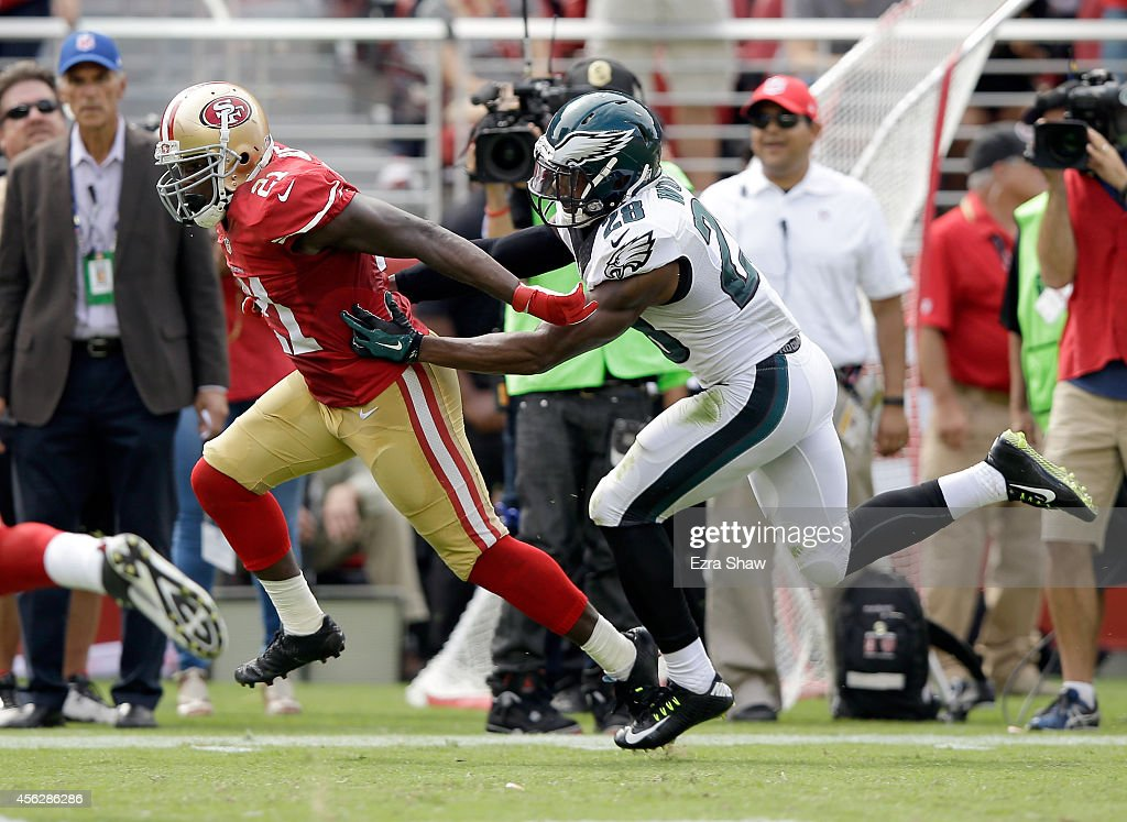 <a gi-track='captionPersonalityLinkClicked' href=/galleries/search?phrase=Frank+Gore&family=editorial&specificpeople=233698 ng-click='$event.stopPropagation()'>Frank Gore</a> #21 of the San Francisco 49ers breaks free from <a gi-track='captionPersonalityLinkClicked' href=/galleries/search?phrase=Earl+Wolff&family=editorial&specificpeople=6379729 ng-click='$event.stopPropagation()'>Earl Wolff</a> #28 of the Philadelphia Eagles on his way to running in for a touchdown at Levi's Stadium on September 28, 2014 in Santa Clara, California.