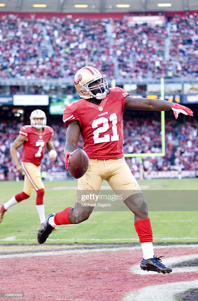 Frank Gore #21 of the San Francisco 49ers celebrates after scoring on a 2-yard touchdown run to set a franchise record for most rushing touchdowns during the game against the Arizona Cardinals at Candlestick Park on December 30, 2012 in San Francisco, California. The 49ers defeated the Cardinals 27-13.