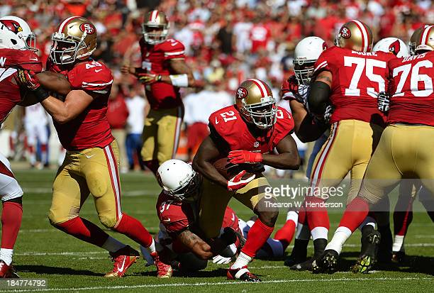 Frank Gore of the San Francisco 49ers gets tackled by Yeremiah Bell of the Arizon Cardinals during the second quarter at Candlestick Park on October...