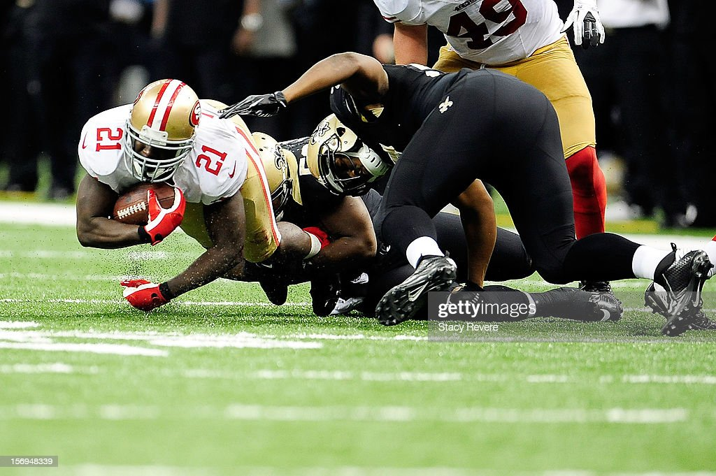 <a gi-track='captionPersonalityLinkClicked' href=/galleries/search?phrase=Frank+Gore&family=editorial&specificpeople=233698 ng-click='$event.stopPropagation()'>Frank Gore</a> #21 of the San Francisco 49ers is brought down by <a gi-track='captionPersonalityLinkClicked' href=/galleries/search?phrase=Curtis+Lofton&family=editorial&specificpeople=4060659 ng-click='$event.stopPropagation()'>Curtis Lofton</a> #50 of the New Orleans Saints during a game at the Mercedes-Benz Superdome on November 25, 2012 in New Orleans, Louisiana.