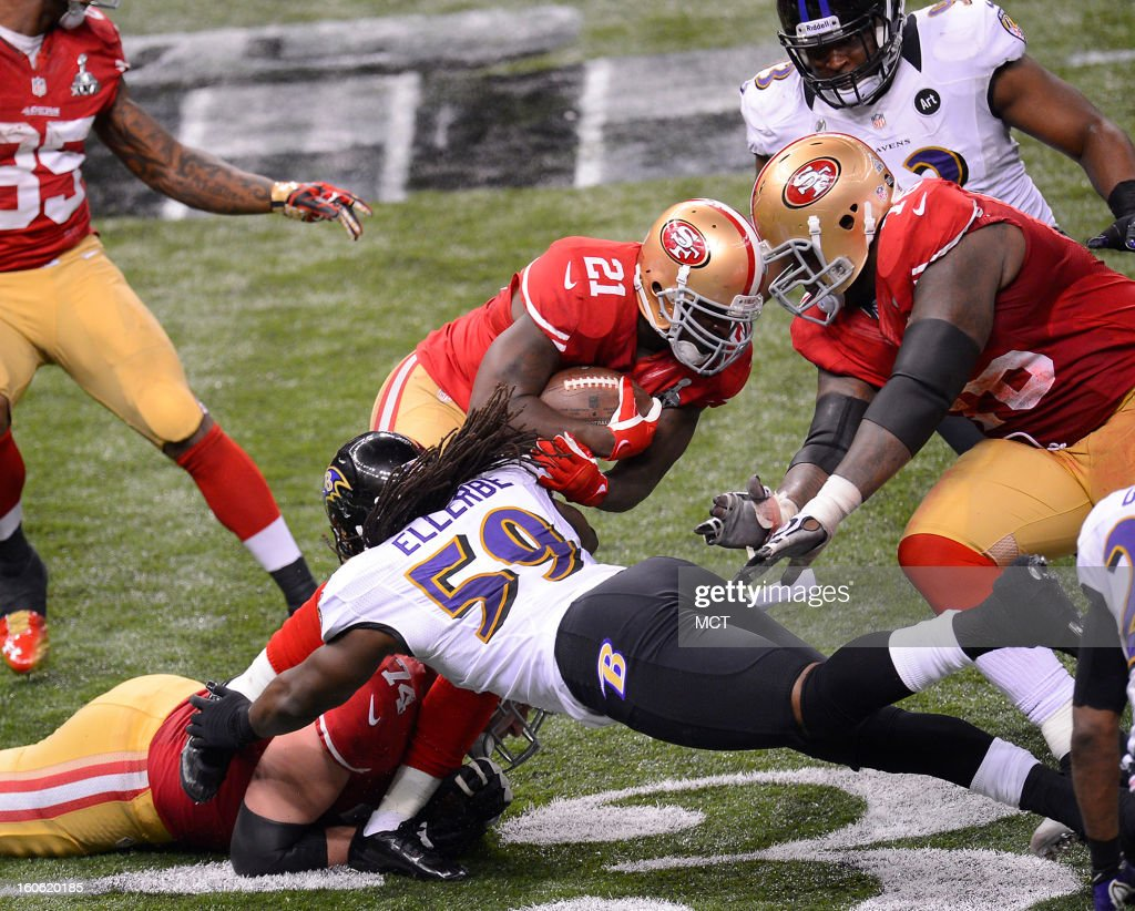 Frank Gore (21) of the San Francisco 49ers is tackled by Dannell Ellerbe (59) of the Baltimore Ravens in Super Bowl XLVII at the Mercedes-Benz Superdome in New Orleans, Louisiana, Sunday, February 3, 2013.