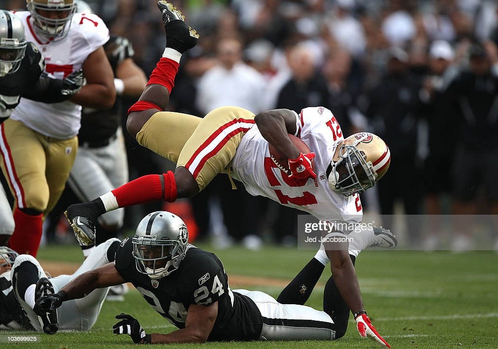 Frank Gore #21 of the San Francisco 49ers runs against Michael Huff #24 of the Oakland Raiders during an NFL preseason game at Oakland-Alameda County Coliseum on August 28, 2010 in Oakland, California.