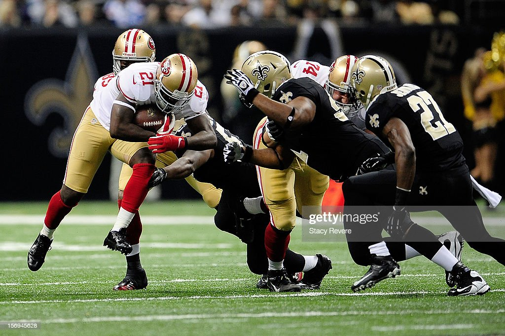 Frank Gore #21 of the San Francisco 49ers runs for yards against the New Orleans Saints during a game at the Mercedes-Benz Superdome on November 25, 2012 in New Orleans, Louisiana.
