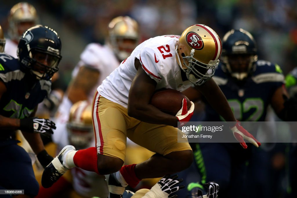 <a gi-track='captionPersonalityLinkClicked' href=/galleries/search?phrase=Frank+Gore&family=editorial&specificpeople=233698 ng-click='$event.stopPropagation()'>Frank Gore</a> #21 of the San Francisco 49ers runs the ball against the Seattle Seahawks during their game at Qwest Field on September 15, 2013 in Seattle, Washington.