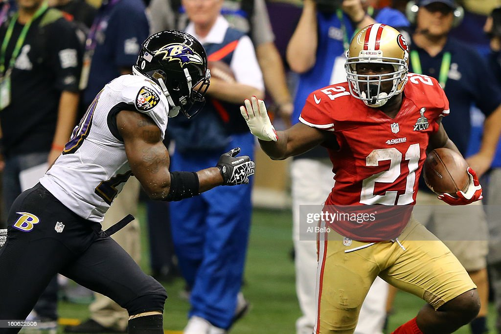 <a gi-track='captionPersonalityLinkClicked' href=/galleries/search?phrase=Frank+Gore&family=editorial&specificpeople=233698 ng-click='$event.stopPropagation()'>Frank Gore</a> #21 of the San Francisco 49ers runs with the ball before stiff-arming <a gi-track='captionPersonalityLinkClicked' href=/galleries/search?phrase=Ed+Reed&family=editorial&specificpeople=194933 ng-click='$event.stopPropagation()'>Ed Reed</a> #20 of the Baltimore Ravens during Super Bowl XLVII at the Mercedes-Benz Superdome on February 3, 2013 in New Orleans, Louisiana.