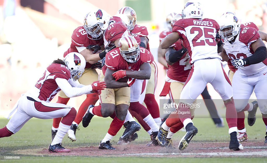 Frank Gore #21 of the San Francisco 49ers rushes during the game against the Arizona Cardinals at Candlestick Park on December 30, 2012 in San Francisco, California. The 49ers defeated the Cardinals 27-13.