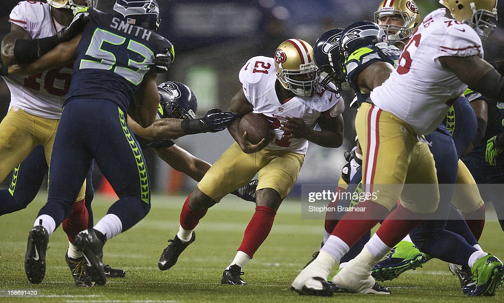 <a gi-track='captionPersonalityLinkClicked' href=/galleries/search?phrase=Frank+Gore&family=editorial&specificpeople=233698 ng-click='$event.stopPropagation()'>Frank Gore</a> #21 of the San Francisco 49ers rushes the ball against the Seattle Seahawks during a game at CenturyLink Field on December 23, 2012 in Seattle, Washington.