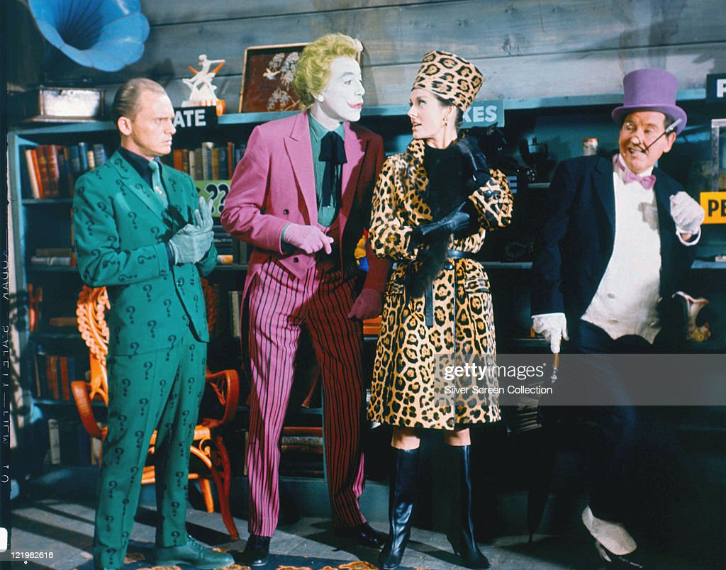 Frank Gorshin US actor and comedian Cesar Romero Lee Meriwether US actress and Burgess Meredith US actor all in costume in a publicity still issued...