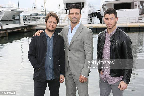 Frank Grillo Byron Balasco and Nick Jonas pose for 'Kingdom' Photocall during MIPCOM 2014 at Pantiero on October 14 2014 in Cannes France