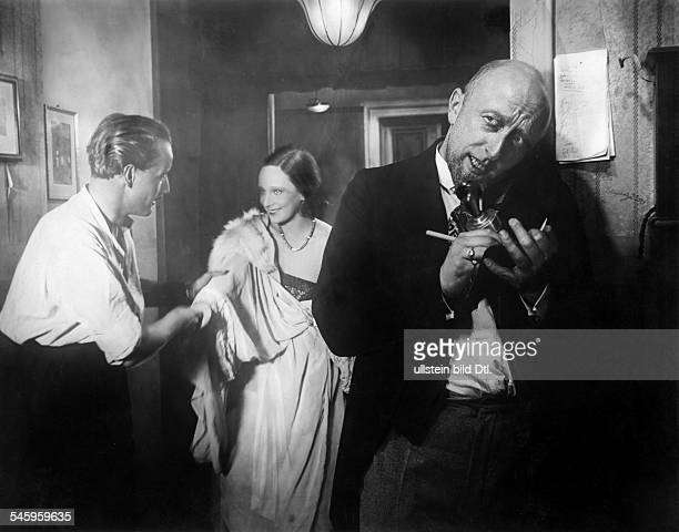 Frank Guenther Esmee Symon and Constantin Mic in the film 'Farewell' directed by Robert Siodmak 1930
