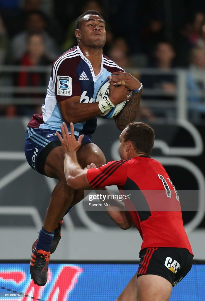 Frank Halai of the Blues takes the high ball ahead of <a gi-track='captionPersonalityLinkClicked' href=/galleries/search?phrase=Israel+Dagg&family=editorial&specificpeople=2086281 ng-click='$event.stopPropagation()'>Israel Dagg</a> of the Crusaders during the round 3 Super Rugby match between the Blues and the Crusaders at Eden Park on March 1, 2013 in Auckland, New Zealand.