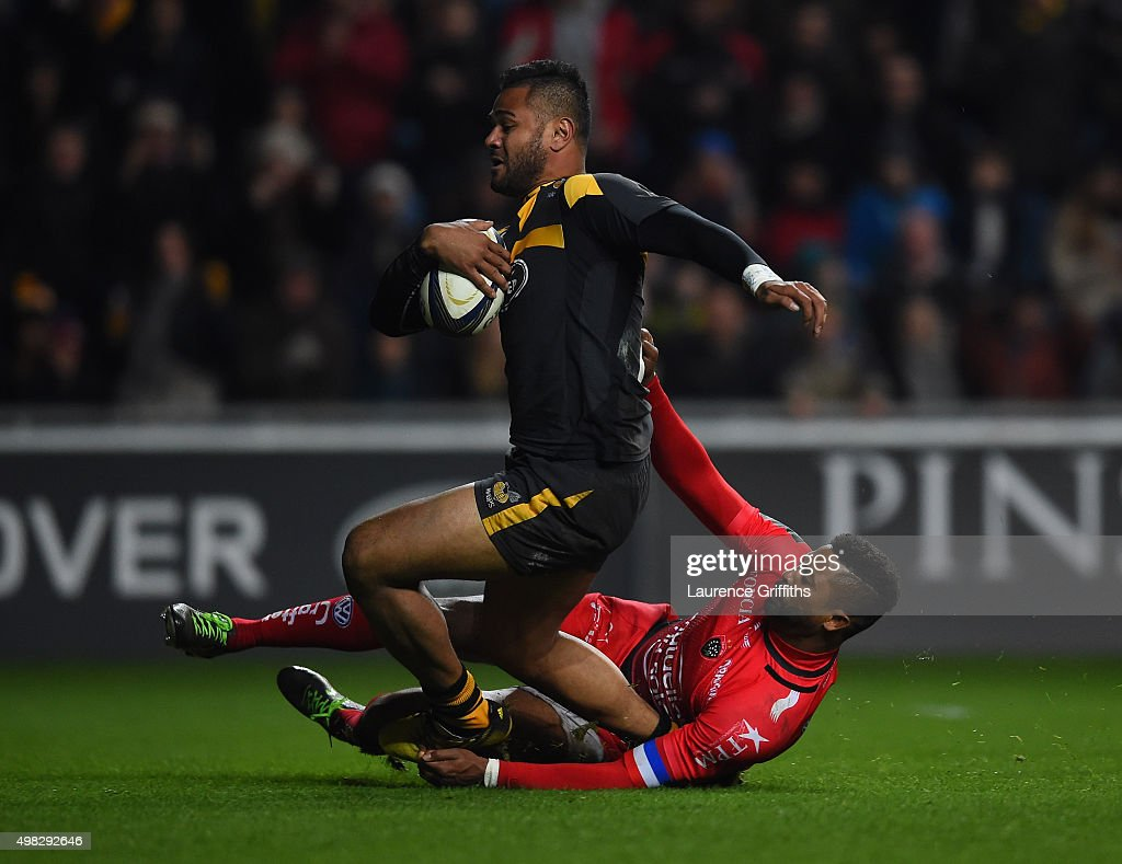 <a gi-track='captionPersonalityLinkClicked' href=/galleries/search?phrase=Frank+Halai&family=editorial&specificpeople=7371670 ng-click='$event.stopPropagation()'>Frank Halai</a> of Wasps scores a try under pressure from <a gi-track='captionPersonalityLinkClicked' href=/galleries/search?phrase=Delon+Armitage&family=editorial&specificpeople=556925 ng-click='$event.stopPropagation()'>Delon Armitage</a> of Toulon during the European Rugby Champions Cup match between Wasps and Toulon at Ricoh Arena on November 22, 2015 in Coventry, England.