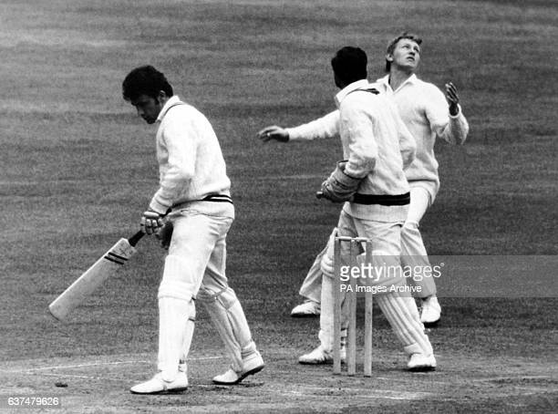 Frank Hayes at slip does a juggling act as he catches the ball off the pad of Jones from the bowling of Hughes Farokh Engineer is the wicket keeper