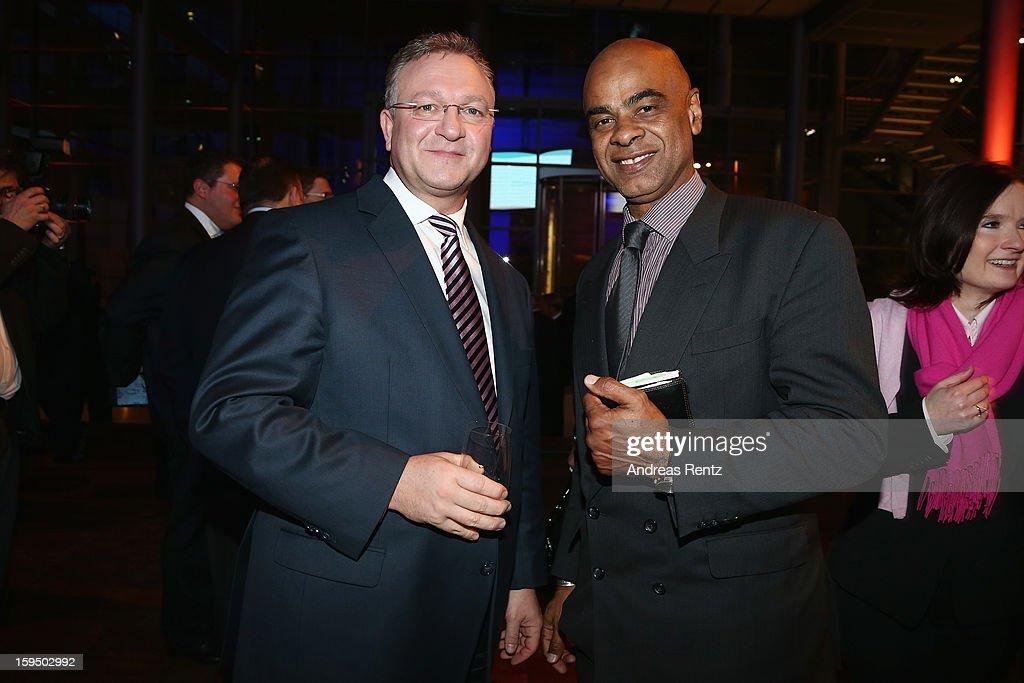 Frank Henkel and Charles Huber attend the '8. Nacht der Sueddeutschen Zeitung' at Deutsche Telekom representative office on January 14, 2013 in Berlin, Germany.