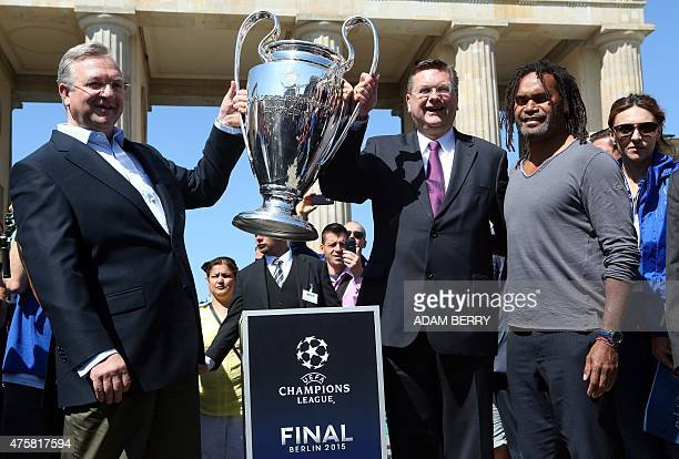 Frank Henkel Berlin's interior and sport secretary Rainer Grindel treasurer of the German football association and Christian Karembeu retired French...