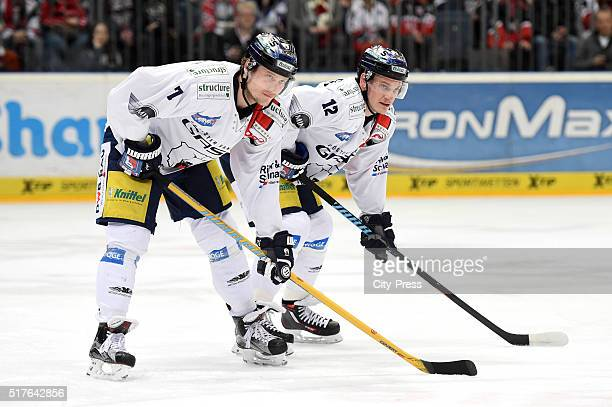 Frank Hoerdler and Laurin Braun of the Eisbaeren Berlin during the DEL playoff match between Koelner Haie and the Eisbaeren Berlin on March 26 2016...