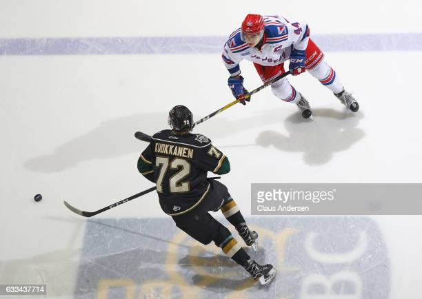 Frank Hora of the Kitchener Rangers defends against Janne Kuokkanen of the London Knights during an OHL game at Budweiser Gardens on February 1 2017...