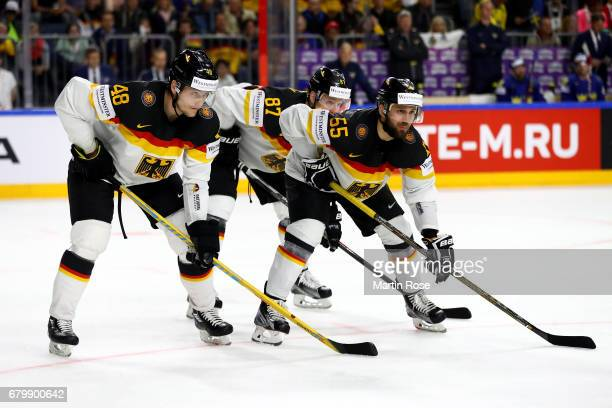 Frank Hordler and Felix Schuetz of Germany look on during the 2017 IIHF Ice Hockey World Championship game between Germany and Sweden at Lanxess...