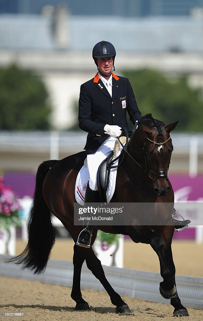 Frank Hosmar of Holland rides Alphaville to win Bronze during the Equestrian Dressage Individual Freestyle Test - Grade IV on day 6 of the London 2012 Paralympic Games at Greenwich Park on September 4, 2012 in London, England.