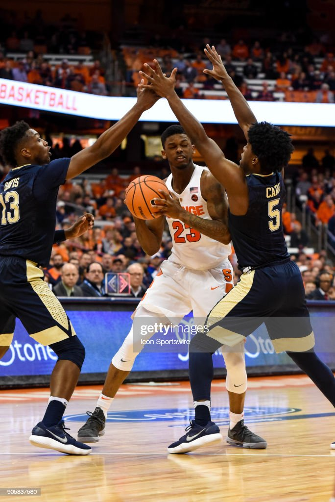 Frank Howard #23 of the Syracuse Orange drives to the basket between Marcus Carr #5 and Khameron Davis #13 of the Pittsburgh Panthers during the second half of play between the Syracuse Orange and the Pittsburgh Panthers on January 16th, 2018 at the Carrier Dome in Syracuse, NY.